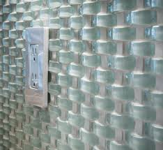 wavy glass tile as backsplash electrical outlet plate or