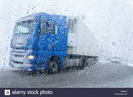 Trucks In The Rain And Snow On The Road Stock Photo: 281719142 - Alamy