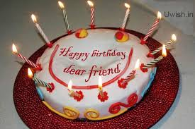 Happy Birthday dear friend e greetings and wishes with smile on cake