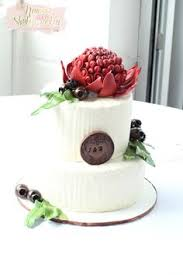 Rustic Buttercream Wedding Cake Adorned With Handmade Sugar Flowers Weddingcake