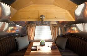Airstream Dining Area Before In With Cushions And Plates