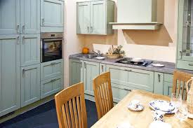Traditional Kitchen With Painted Mint Green Cabinets And Wood Dining Table