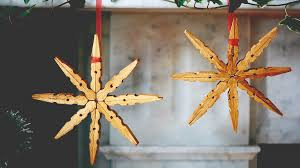 stars made of wooden pegs diy christmas decorations tesco
