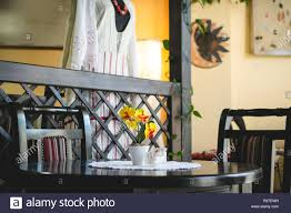 Dark Color Table With Two Chairs And Yellow Flowers In The ...