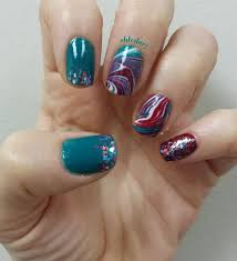 Water Marble Design On Middle Ring Nails With Dark Turquoise Maroon And White Thumb Pointer Solid Color Sparkle At Tips