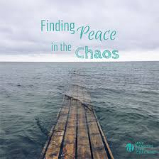 Image Of Pier Extending Into Calm Water With Quote Overlaid Finding Peace In The Chaos