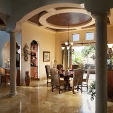 Mediterranean Dining Room With Vaulted Ceiling