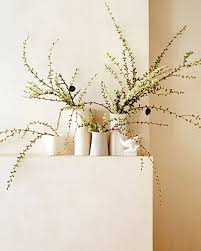 Spring Branches In Small White Vases