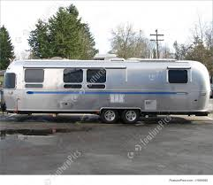 Old Silver And Blue Caravan Royalty Free Stock Picture