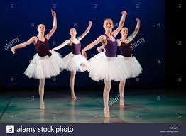 four 4 young 14 15 16 year old teenage student ballet dancers