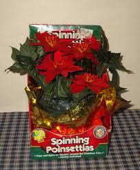 Who Sings Rockin Around The Christmas Tree by Spinning Poinsettias Gemmy Wiki Fandom Powered By Wikia