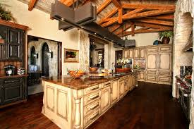Awesome Rustic Spanish Style Kitchen Decorating Designs With Vintage Off White Island And Cabinets On Barn Wood Floors As Well Wooden Ceiling Exposed