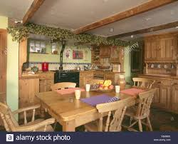 100 Cieling Beams Dried Hop Garland On Ceiling Beams On Fitted Wooden Kitchen