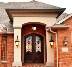 rustic wrought iron door with brick wall effect plus pendant l