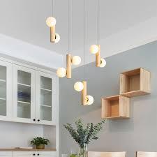 moderne pendelleuchte magische bohne aus holz für wohnzimmer