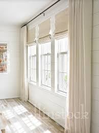 stock image of a row of three windows on a white wall with ivory