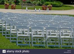 Rows Of White Folding Chairs On Lawn Of Botanic Garden Stock ... Set Of Four Stacking Garden Chairs And Matching White Folding Table In Cambridge Cambridgeshire Gumtree Modern Wooden Folding Director Or Garden Chair On A Background 7 Position Adjustable Back Outdoor Fniture Foldable Rattan Chairs With Foot Rest Buy White Canvas Rows Lawn Botanic Stock Close Up Slatted Wooden Chair Intertional Caravan Royal Fiji Acacia High Bluewhite Camping Wedding Rental Sky Party Rentals Vidaxl 2x Hdpe Balcony Seat 225