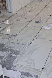 tile installation backer board around a bathtub tile