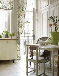 Country Shabby Chic Kitchen Decor With Beautiful Floral Fabric And Green Plants