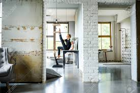100 Loft Style Apartment A Young Handsome Dancer Relaxing In A Loft Style Apartment