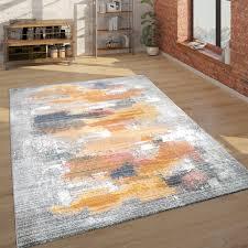 teppich wohnzimmer abstraktes muster grau gelb rot