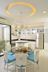 To Separate The Dining Area From Kitchen Clear Definition Of Space Is Provided By Recessed Ceiling Which In Turn Mimics Circular Shape