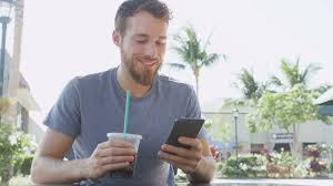 Man Sms Texting Using App On Smart Phone At Cafe Drinking Iced Coffee In City Summer Handsome Young Casual Smartphone Smiling Happy Sitting