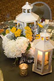 Adorable White Rustic Lantern Centerpiece Combined With Yellow And Flowers Along
