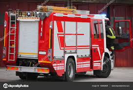 100 Emergency Truck Fire Truck In An Emergency And Active People Stock Photo