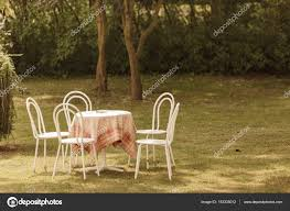 Vintage Looking Chairs And Round Table In Park — Stock Photo ... How To Use Brown Antique Fniture Furnishings House Folding Chair Stock Photos Cheap Cane Chairs Find Deals On Paint A Ding Room Table Home Guides Sf Ca1900 Antique Set 6 Oak Victorian P Derby Tback Small Button Back Hot Item New Design Two Sides Arch Set Wedding Backdrop For Party Vbanquet Decoration Elbow Elm Bowback Smokers Captains Desk C1880 Lighting Light Fixtures With Large Applying Decorative Upholstery Tacks And Nailhead Trim Woodleather Folding Stool History Britannica