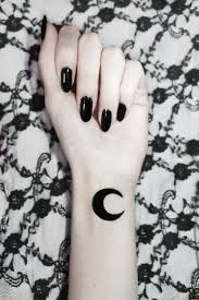 Black Silhouette Gothic Moon Tattoo On Left Wrist