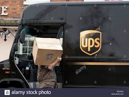 UPS Parcels Delivery Van With Driver Carrying A Large Parcel Stock ... 18 Secrets Of Ups Drivers Mental Floss The Truck Is Adult Version Of Ice Cream Mirror Front Center Roy Oki Has Driven The Short Route To A Long Career Truck And Driver Unloading It Mhattan New York City Usa Plans Hire 1100 In Kc Area The Kansas Star Brussels July 30 Truck Driver Delivers Packages On July Stock Picture I4142529 At Featurepics Electric Design Helps Awareness Safety Quartz Real Fedex Package Van Skins Mod American Simulator Exclusive Group Formed As Wait Times Escalate Cn Ups Requirements Best Image Kusaboshicom By Tricycle Portland Fortune