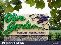 A logo sign outside of an Olive Garden restaurant location in