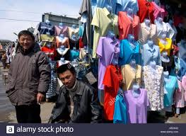 chinese migrant workers running market stalls selling chinese
