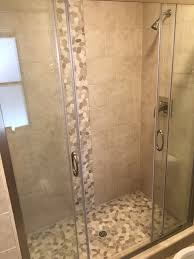 sliced white pebble tile shower floor and accent pebble