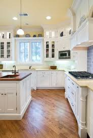 Fabulous White Kitchen Cabinets Wooden Floor Yellow With Cherry Wood Floors