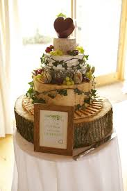 A Rustic Display With Crackers Leaves And Grapes