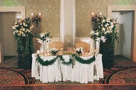 Beach Sand Hotel Ballroom Sweetheart Table With Green Garlands
