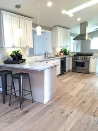 Kitchens With Dark Cabinets And Wood Floors by White Kitchen Cabinets With Grey Wood Floors Dark Light Hardwood