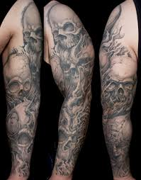 Collection Of 25 Grey Ink Flaming Skulls Tattoos On Sleeve