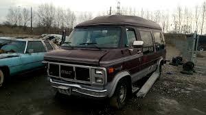 Old GMC Vandura Starcraft Conversion Van At The Junk Yard