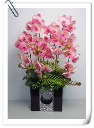 I have been studying flower arrangement for years I love doing the