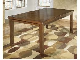 Ralene Butterfly Extension Dining Table In Medium Brown