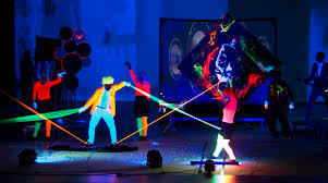 This Performance Troupe Does Some Cool Stuff With Black Light Effects…