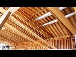 Vaulted Ceiling Joist Hangers by Installing Wood Ceiling Joists Or Beams Youtube