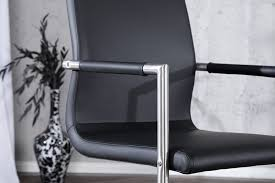 freischwinger columbia mit armlehnen schwarz dunord design