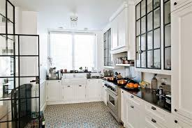 lovely vintage kitchen with decorative ceramic floor tiles also