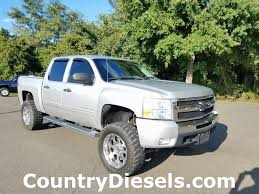 2010 Used Chevrolet Silverado 1500 LT Lifted At Country Diesels ... Chevrolet And Gmc Slap Hood Scoops On Heavy Duty Trucks 2019 Silverado 1500 First Look Review A Truck For 2016 Z71 53l 8speed Automatic Test 2014 High Country Sierra Denali 62 Kelley Blue Book Information Find A 2018 Sale In Cocoa Florida At 2006 Used Lt The Internet Car Lot Preowned 2015 Crew Cab Blair Chevy How Big Thirsty Pickup Gets More Fuelefficient Drive Trend Introduces Realtree Edition