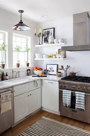 White Cabinets With Carrara Marble Countertop Of Countryside Kitchen Decoration Stainless Steel Ceiling Mounted Range Hood Finishing Oak Plank Floors
