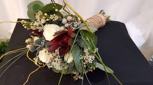 Unique Rustic Bridal Bouquet Of Ivory Roses Safari Sunset Wax Flower Thistle Brunia Berries Williow Branches Bear Grass And Eucalyptus Finished With